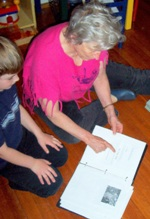 Mary Gilbert Reading with Grandson Nathan